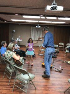 Mark Dvorak dancing with little girl
